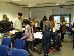 Students giving peer feedback in Reframing workshop