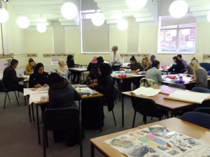 Students working on individual collages and discussing in groups
